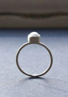 Little White One. Clear glazed porcelain gem, plain bezel flat setting, 100% recycled silver.   Liv Thrane Jewellery.  www.facebook.com/livthranejewellery & www.livthrane.com