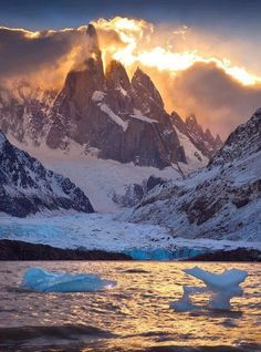 Fire and Ice by michaelanderson on deviantART Laguna Torre, Los Glaciares National Park, Patagonia, Argentina. A fiery sunset illuminates Cerro Torre and the cold icebergs of Laguna Torre, one of the most beautiful lakes in all of Patagonia. Places To Travel, Places To See, Travel Destinations, Holiday Destinations, Places Around The World, Around The Worlds, Beautiful World, Beautiful Places, Amazing Places