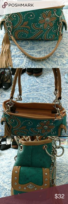 Montana West concealed carry purse Awesome purse with three compartments inside and concealed carry zipper pouch on the back turquoise with tan trim lots of bling missing one silver rivet on the front as pictured otherwise in perfect condition. Montana West Bags