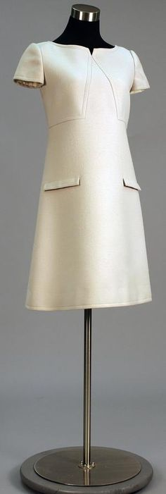 Day dress of pale blue/gray wool. Above the knee length