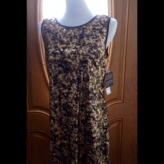 Nine West Gold and Black Dress This is a beautiful black and gold sequin dress.  New never been worn. It is fully lined.  Knee length. Zipper in the back. True size ten. Some stretch.  Made from 100% polyester.  Dry clean only. Nine West Dresses