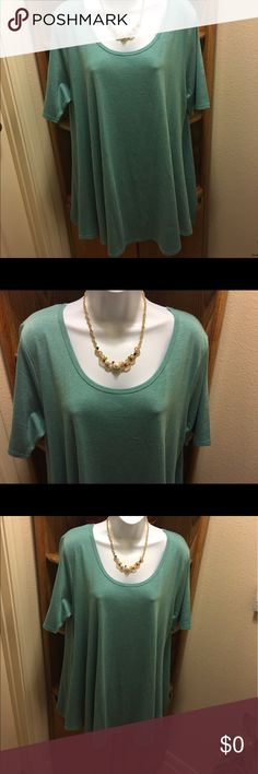 LuLaRoe Perfect T - NWT Brand New / with Tags Sz.  XL.  Softest T-shirt fabric with a 48% Poly, 47% Cotton, 5% Spandex. Heathered muted Aqua (blue-green) shade. Side slits allow top to flow over hips in a slimming manner. LuLaRoe Tops Tees - Short Sleeve
