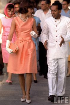 Jackie Kennedy at the Palace of the Maharajah in Udaipur, India during a state visit, wearing a fitted silk apricot dress by designer Oleg Cassini. More At:  http://www.savingjackiek.com/jackiek_fashion.html