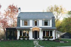 This modern farmhouse style home was created by Jean Stoffer Design along with Kenowa Builders, ideally located in the East Grand Rapids, Michigan. Nestled on the shores of Reeds Lake, this beautif… Dutch Colonial Exterior, Colonial House Exteriors, Dutch Colonial Homes, White Exterior Houses, Colonial Architecture, Home Design, Modern House Design, Design Ideas, Patio Design