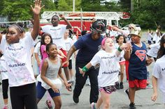 """Brockton firefighter Victor Soto-Perez, dances to the """"Watch Me"""" during annual Hancock Husky Pride Day on Monday, June 13, 2016, at the Hancock School in Brockton. — Marc Vasconcellos/The Enterprise"""