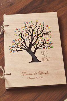 "Custom Wedding guest book wood rustic wedding guest book album bridal shower engagement anniversary- ""Love Tree - Tree of Life"". $42.00, via Etsy."