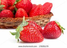 Closeup of fresh strawberries over white background. by eZeePics Studio, via Shutterstock