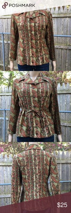 """Vintage Handmade Paisley Carol Brady Top Wow! This shirt is a flashback and a half! It's very Carol Brady from the Brady Bunch.   It features a muted paisley print, buttons down and has a little tie that can be worn as a choker or a belt for a customized style.   No size tag but is about a size XL.  Measurements (flat): Armpit to armpit: 18.5"""" Waist: 16.76"""" Bottom hem: 20"""" Length: 17"""" Shoulder to shoulder: 16.75"""" Sleeve: 18""""  Condition: pre-worn vintage with some wear on the armpits.   A…"""