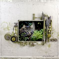 BLISS xoxo.  I absolutely LOVE Heather Jacobs' scrapbooking - she is the mixed media QUEEN and I aspire to be as good as she is one day !