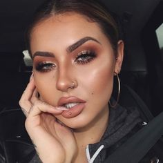 She looks like a drugged clown, I'm certain she is gorgeous under all that shading cream or with a smaller amount of makeup.