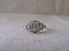 Hey, I found this really awesome Etsy listing at http://www.etsy.com/listing/123161028/art-deco-1930s-engagement-ring-in-18k