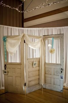 wooden door wedding backdrop | gallery | Lasting Impressions... ok, not for a wedding (did that 28 years ago, not doing it again! LOL), but the doors-as-a-screen idea is great!