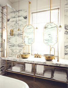 What a terrific bathroom! Lots of glam between the marble, brass and mirrored glass but then they go industrial with the open shelving. The hanging mirrors would be a great way to add privacy without doing the telltale glass blocks or frosted glass. Source: ANNA+NINA Department Store, Amsterdam.