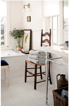 Beautiful with the chair in the bathroom ..... Towels are a lovely colour