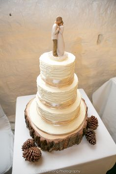Our wedding at East Riddlesden Hall, Keighley. Barn wedding. Christmas wedding. Pine cones. Willow tree Promise cake topper. Wood slice log cake stand.