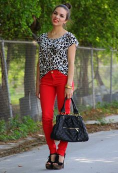 Leopard top with red jeans, black bag and shoes
