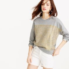 "J. Crew Collection Metallic Lace Sweatshirt This dressed-up sweatshirt features a layer of fancy metallic lace from a famous French mill. -Cotton. -Machine wash. -Loose fit. -Body length: 24 1/4"". -Like New.  No Trades. Please make all offers through offer buttons. J. Crew Tops Sweatshirts & Hoodies"