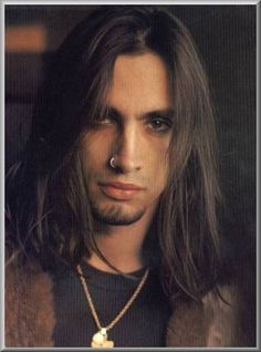 Nuno Bettencourt of Extreme. Best guitar player. Ever. What a waste of his talent in the band Extreme.