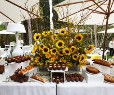 A bread and muffin buffet compliments the colorful sunflowers that loom above.