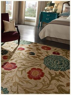 This floral rug is ideal to help incorporate accent colors into a neutral room.