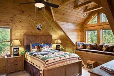 Interior, horizontal, master bedroom with large window seat, Duncan residence, Ferguson, North Carolina; Log Homes of America; Leatherwood Log Homes; 4 Forty Four Builders