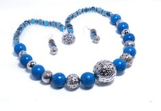Necklace Blue Magnesite (dyed) with faceted round glass beads and silver plated focal and spacers by KelKatCustomJewelry on Etsy