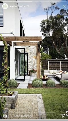 Off white, timber and stone exterior