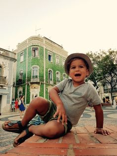 My little model 😍 traveling with our kids, Lagos Algarve Portugal. Love green!