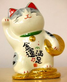 Maneki Neko leaning and holding money
