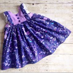 Avery Road Handmade custom order Violette Field Threads Clara purple unicorn birthday dress.  Double ruffles on bodice in fabric and white eyelet lace, fabric covered button closures.