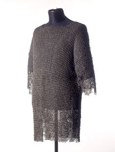 Chain mail shirt, British, 1366-1435. Chain mail was the main type of armor worn in battle from the Iron Age until the 1200s. It was normally riveted - each ring end was flattened and linked by a rivet. Chain mail was time-consuming and expensive to make, so most foot soldiers were equipped with only a padded leather jacket. By the 1300s, greater body protection was needed. Plate armor began to be worn over the chain mail, and had replaced it by the early 1400s.