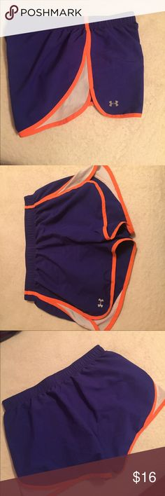 Under Armour running shorts Bright blue Under Armour semi-fit running shorts with neon orange trimming and white mesh on sides. Built in underwear and draw string inside. Size medium. Great condition. Under Armour Shorts