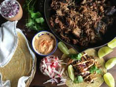Slow Cooker Carnitas With Sriracha Mayo-Meet your new go-to Taco Tuesday recipe: Just throw it in a crockpot before work, and come home to carnitas.