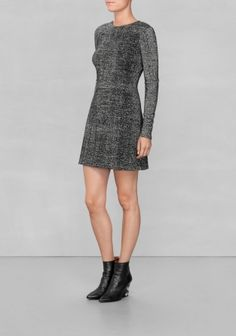 & OTHER STORIES This knitted merino wool dress is made for a figure-tracing fit and is detailed with silvery threads that create a festive aura around the outfit.