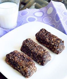 "Hot Fudge Brownie ""Larabars"" recipe: this is a good recipe to bookmark, because these bars are really quick to make and actually taste even better than the packaged Larabars. Plus, they're chocolate!!"