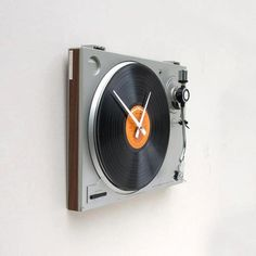 This clock was created using a recycled turntable . nice one! (Designed by pixelthis)
