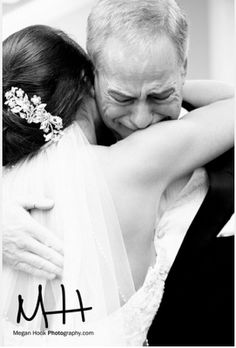 My dad probably wouldn't be emotional but when we hug or when he takes off my veil  this would be a good picture right before i'm about to make vows