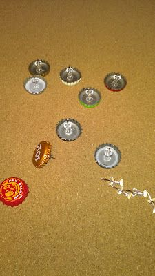 Make decorative push pins from old bottle caps. Now, I can justify my reason for hoarding bottle caps!