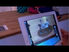 Augmented Reality - Testing with App: Spacecraft 3D on iPad 3 (HD)  Augmented reality (AR) is a live, direct or indirect, view of a physical, real-world environment whose elements are augmented by computer-generated sensory input such as sound, video, graphics or GPS data.