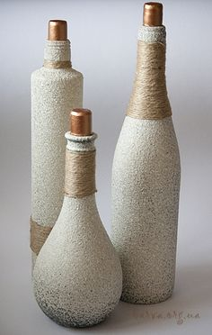Recycle plastic or glass bottles/Textured spray paint & twine Wine Bottle Corks, Glass Bottle Crafts, Diy Bottle, Vodka Bottle, Painted Wine Bottles, Bottles And Jars, Glass Bottles, Decorated Bottles, Bottle Lamps
