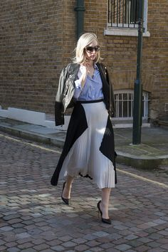 Jane Keltner de Valle added spunk to her polished pleats with a leather jacket. Street Style at London Fashion Week #LFW
