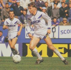 """To a generation of Leeds United fans John Sheridan will remain a firm favourite even if he would struggle to make the """"Best Ever"""" Leeds XI. With a fabulous right-foot in dead ball situations and a pass that could split the best defences he offered class & quality in otherwise poor teams through the 1980's and showed great loyalty to the club he adopted as his own, despite being born in Manchester to Irish descendants and being linked with some of the biggest clubs in the UK & abroad"""