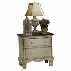 "Two-drawer New Zealand pine wood nightstand in antiqued white with twist detail and a hand-rubbed finish.  Product: Nightstand    Construction Material: New Zealand pine    Color: Antique white      Dimensions: 30.25""  H x 30""  W x 19""  D"