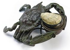 """CRAB"""" INKSTAND impressed TIFFANY STUDIOS/NEW YORK/23547/3 with the Tiffany Glass and Decorating Company monogram patinated bronze and mounted shell with the original interior clear glass inkwell 3 1/2  x 7 3/4  x 7 5/8  in. (8.9 x 19.7 x 19.4 cm) circa 1905 Read Con"""