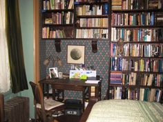 Jane Yolen writing in New York-  A corner of the guest room at Ellen and Delia's apartment on the upper west side of Manhattan--with American Arts-&-Crafts wallpaper, William Morris sheets, velvet & lace at the window, and plenty of books to read.