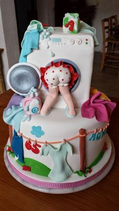 Novelty washing machine and clothes themed cake