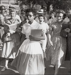 Elizabeth Eckford and Hazel Massery; Will Counts, 1957  Elizabeth Eckford was one of the first black students admitted to Central High School in Little Rock, Arkansas. This photo shows her grueling walk to class while being shouted at by white student Hazel Massery. Although Massery would later express regret for her actions, the photo showed the nation and the world the heated strife in the Southern United States.