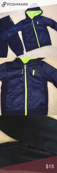 Reebok Hoodie and Jogger Set Navy blue, Royal blue and neon green. Zippered hoodie with three real pockets. Pants have piling but it's not very noticeable when worn. No holes or stains. Jacket looks like new. Gently used. Bundle and save more. Reebok Matching Sets