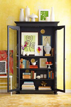 Display case as bookcase; mix in decorative objects and wall art.