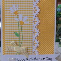 handmade Mother's Day card from Heart Prints ... cheerful yellows with white ... pretty card ... luv the Memory Box daisy die cuts  and delightful lacy border die cut ...